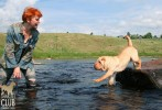 Tatiana bathed in rubber boots, but the cream shar pei Rebecca enjoyed it